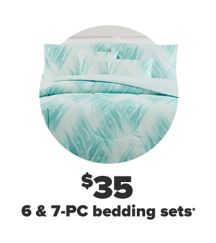 A blue and white matching comforter and pillow set. $35 six and seven piece bedding sets.