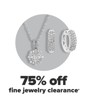 A silver necklace with a diamond pendant. Silver hoop earrings with encrusted diamonds. 75% off fine jewelry clearance.
