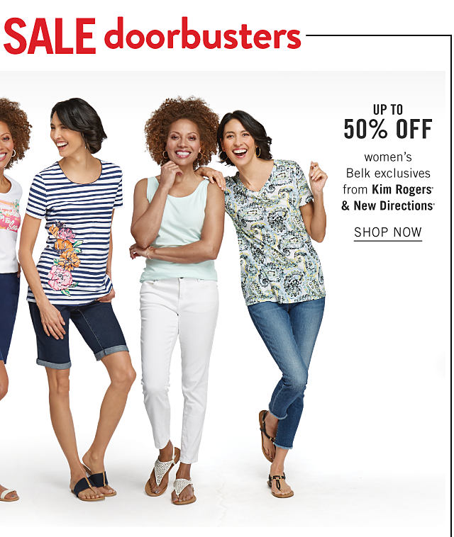 A woman wearing a white tee with a multi colored front graphic, navy shorts & white sandals standing next to a woman wearing a navy & white horizontal striped short sleeved top with a side floral print. denim shorts & navy flat sandals standing next to a woman wearing a white tank top, white pants & white flat sandals standing next to a woman wearing a multi colored paisley print short sleeved top, blue jeans & flat sandals. Doorbuster. Up to 50% OFF. women's Belk exclusives from Kim Rogers & New Directions. Shop now.