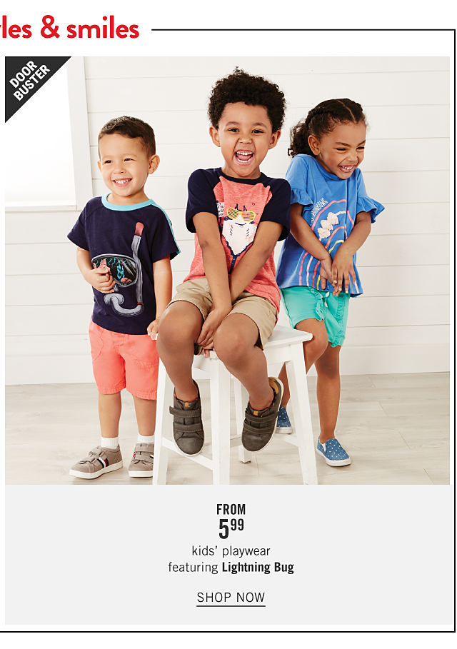 A boy wearing a navy T shirt with a multi colored front graphic, coral shorts & brown sneakers standing next to a boy wearing a coral T shirt with navy sleeves & a multi colored front graphic, beige shorts & black sneakers & a girl wearing a light blue T shirt with a multi colored front graphic, teal shorts & light blue sneakers. Doorbuster. From $5.99 kids playwear featuring Lightning Bug. Shop now.