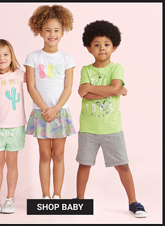 A boy wearing a light blue, navy & white shark graphic tee.. blue & light blue horizontal striped shorts & gray sneakers. A girl wearing a pink teal & gold Hug It Out graphic tee, mint green shorts & light gray sneakers. A girl wearing a white tee with a multi colored pineapple front graphic. a multi colored pastel skirt & white sneakers. A boy wearing a lime green tee with a multi colored front graphic, gray shorts & black sneakers. Belk Days. Over 200 Bonus Buys. Prices So Low You Don't Need A Coupon. $6 & up kids playwear featuring Lightning Bug. Exclusively at Belk. Shop baby.