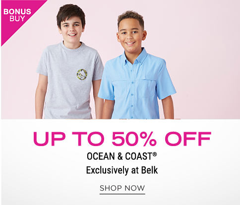 A boy wearing a salmon T shirt & beige shorts standing next to a boy wearing a light blue short sleeved button front shirt & beige shorts. Bonus Buy. Up to 50% off Ocean & Coast. Exclusively at Belk. Shop now.