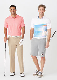 A man wearing a coral polo, black pants & white sneakers standing next to a man wearing a multi colored horizontal striped polo, beige pants & white sneakers. Shop golf apparel.