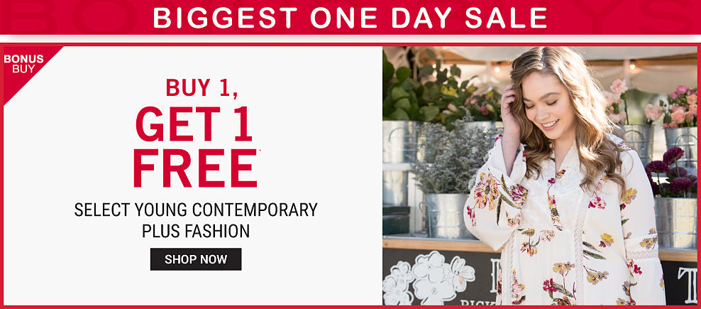 A young woman wearing a white long sleeved dress with a multi colored floral print. Biggest One Day Sale. Buy 1, Get 1 Free select young contemporary plus fashion. Free item must be of equal or lesser value. Shop now.