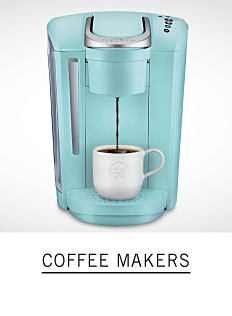 A coffee maker and a coffee cup. Shop coffee makers.
