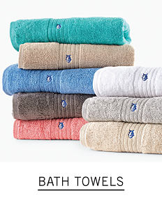 Two stacks of folded towels in a variety of colors. Shop bath towels.