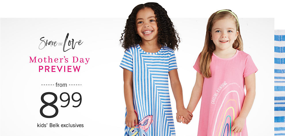 1c29b0801915ca Kids. A girl wearing a light blue   white striped short sleeved dress with  a multi colored