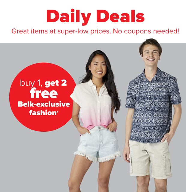 A young woman in a white to pink gradient button down shirt and distressed light wash jean shorts. A young man in a navy patterned button down shirt and khaki cargo shorts. Buy one, get two free Belk exclusive fashion.
