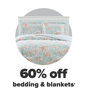 A light blue bedding set with pink flowers. 60% off bedding and blankets.