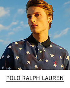 A young man wearing a black polo with a multi colored star patterned print. Shop Polo Ralph Lauren.
