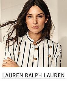 A young woman wearing a white & gray vertical striped long sleeved button front jacket. Shop Lauren Ralph Lauren.