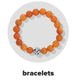 An orange bead stretch bracelet with a silver bead accent. Bracelets.