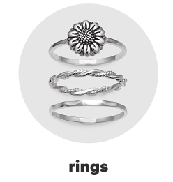 Three silver rings, two with designed bands and one with a sunflower design. Rings.