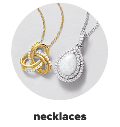 A gold necklace with an intertwined pendant. A silver necklace with a white teardrop pendant. Necklaces.