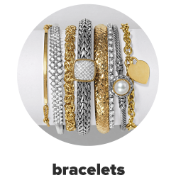 A variety of gold and silver bracelets in a variety of designs. Bracelets.