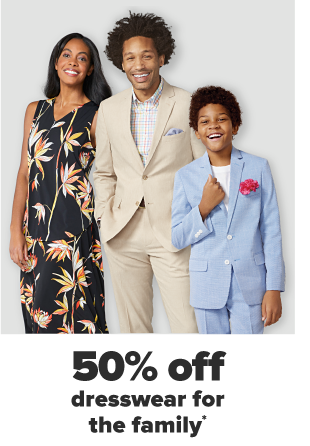 A woman in a black and white gingham dress with a cream colored sweater over top. A man in a cream colored suit with a white shirt underneath. A little boy in a matching light blue suit with a pink flower in the pocket. Up to 50% off dress wear for the family.