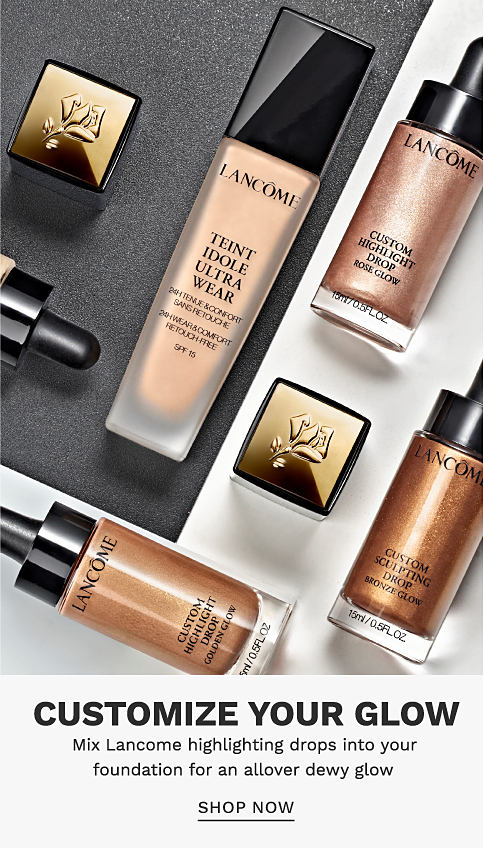 A variety of highlighting products and a bottle of foundation. Customize your glow. Mix Lancome highlighting drops into your foundation for an allover dewy glow. Shop Now.