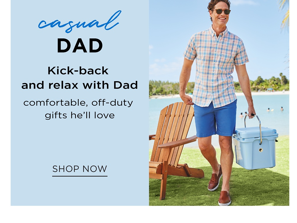 A man wearing a multi colored check patterned short sleeved button front shirt, blue shorts & brown suede loafers. Casual Dad. Kick back and relax with dad. Comfortable, off duty gifts he'll love. Shop now.
