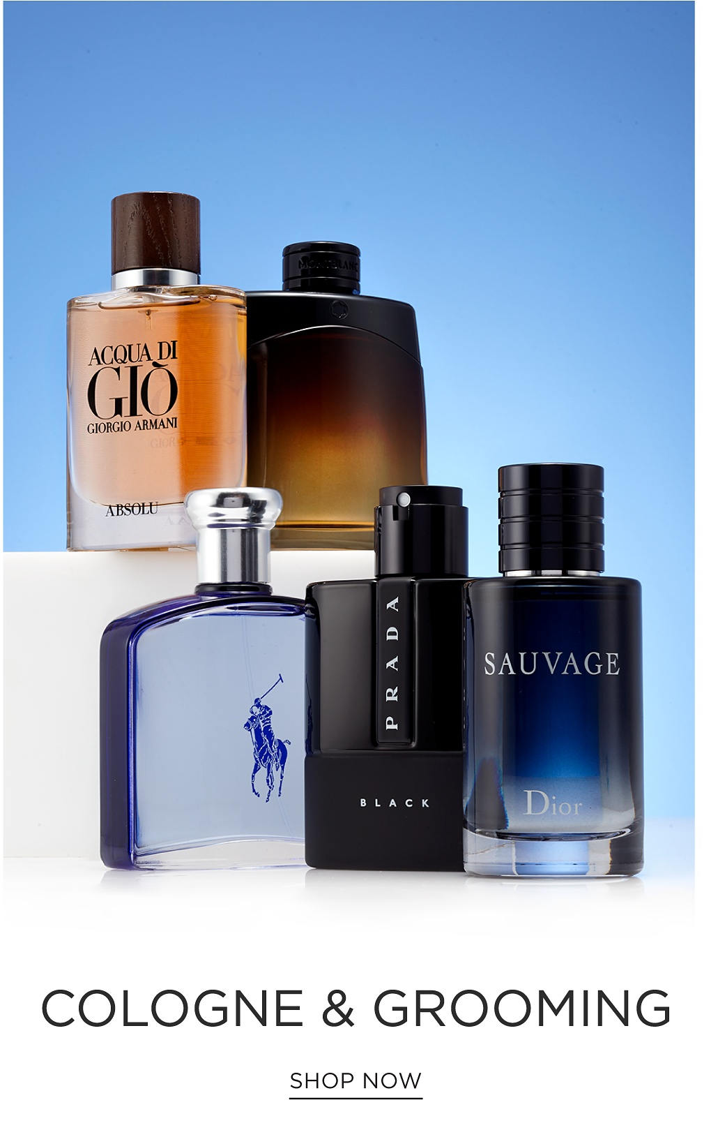 An assortment of men's cologne bottles. Cologne & Grooming. Shop now