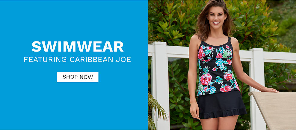 A woman wearing a black 1 piece swimsuit with a multi colored floral print. Swimwear featuring Caribbean Joe. Shop now.