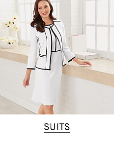 06900c04124c0 A woman with medium length brown hair wearing a two piece suit in white,  lined
