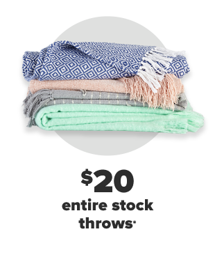 A stack of throw blankets in blue, pink, gray and teal. $20 entire stock throws.