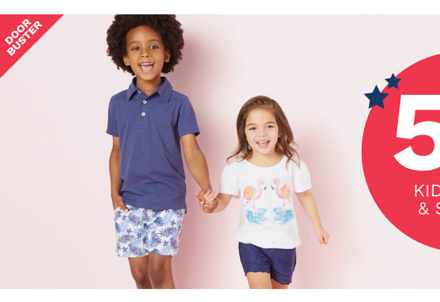 A boy wearing a blue polo & multi colored print shorts standing next to a girl wearing a multi colored print graphic tee & navy shorts. Doorbuster. $5.95 & up kids tops & shorts.
