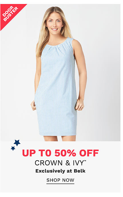 A woman wearing a light blue sleeveless dress. DoorBuster. Up to 50% off Crown & Ivy. Exclusively at Belk. Shop now.
