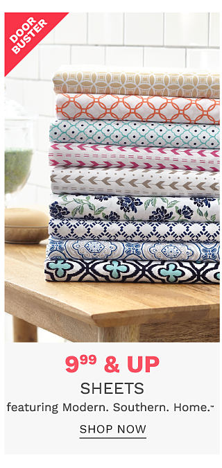 An assortment of folded bed sheetsin a variety of patterns. Doorbuster. $9.99 & up sheets featuring Miodern Southern Home. Shop now.