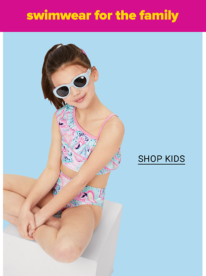 A girl in a blue and pink printed bikini and sunglasses, shop kids.