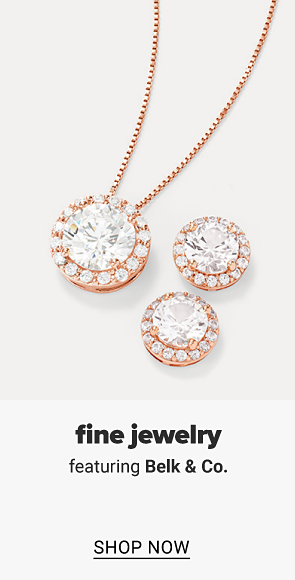 A necklace with a diamond pendant and diamond earrings. Fine jewelry featuring Belk and Co., shop now.