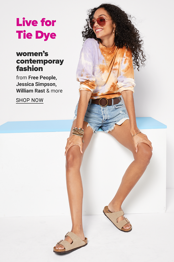 A young woman in a tie dye top, denim shorts, tan sandals, bracelets and sunglasses. Women's contemporary fashion from Free People, Jessica Simpson, William Rast and more, shop now.