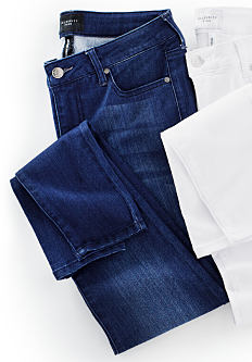 A pair of dark blue jeans & a pair of white jeans. Shop jeans.