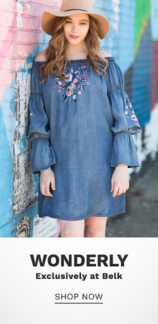 A young woman wearing a beige sun hat & a denim blue long sleeved dress with multi colored floral embroidery detail. Wonderly. Exclusively at Belk. Shop now.