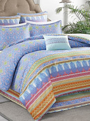A bright blue and yellow bedding set. Shop comforters.