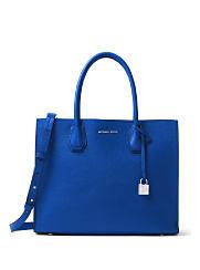 A blue MICHAEL Michael Kors handbag. Shop MICHAEL Michael Kors.