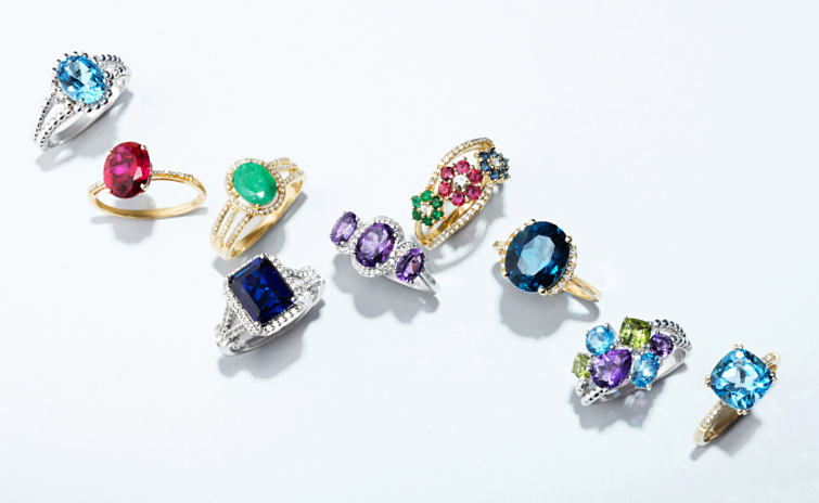 Fine jewelry rings with multicolored gemstones.