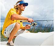 A man fishing, wearing Columbia gear shop big & tall.