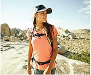 A woman wearing Columbia hiking gear shop women.