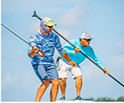 2 men fishing, wearing Columbia Performance Fishing Gear shop PFG.