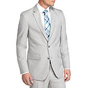 A man wearing a Saddlebred suit shop suit separates.