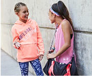 Two girls wearing Under Armour activewear. Shop girls.