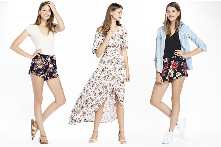 Young women wearing summer outfits including a flowy dress and floral print shorts.