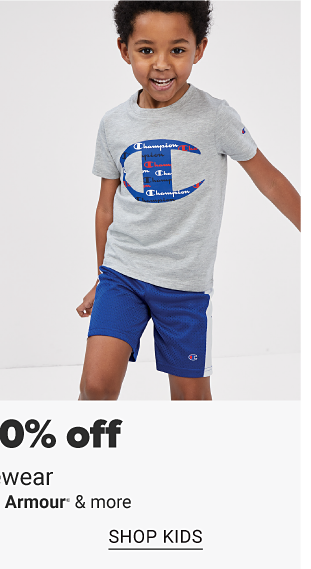 A man in a Nike tee and black shorts. A little boy in a Champion tee and blue shorts. Up to 30% off activewear from Nike, Under Armour and more, shop men, shop kids.