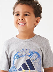 A boy wearing a gray Adidas graphic T-shirt. Shop Boys 4-7.