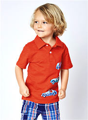 A toddler boy wearing a red button-front shirt and plaid shorts. Shop Toddler Boys.