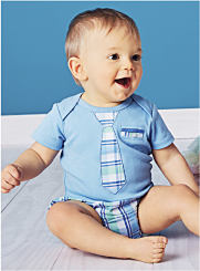 A baby boy wearing a print tee and plaid bottoms. Shop Baby Boys.