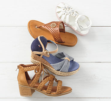Four different pairs of girls' sandals.