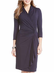 Woman wearing a navy wrap dress. Shop dresses.