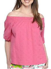 Woman wearing a pink off-the-shoulder top. Shop tops.